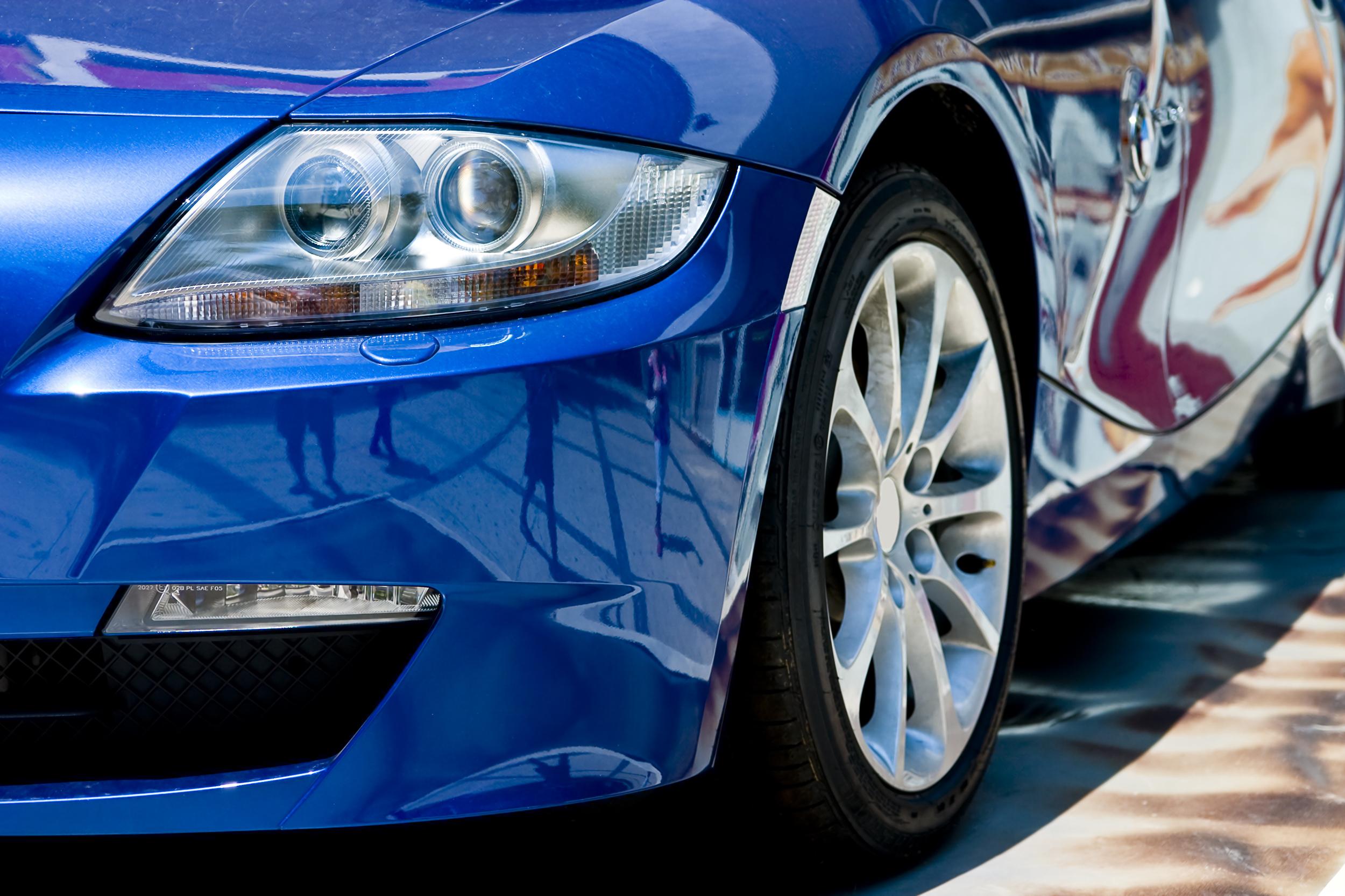 Blue Car Parked-Focus on Headlight